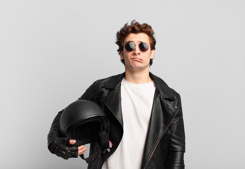 motorbike-rider-boy-feeling-sad-whiney-with-unhappy-look-crying-with-negative-frustrated-attitude.jpg