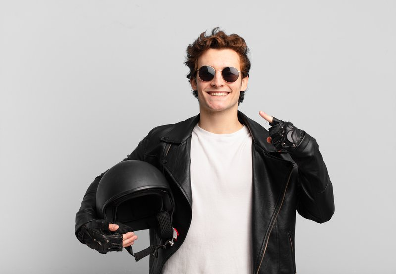 motorbike-rider-boy-smiling-confidently-pointing-own-broad-smile-positive-relaxed-satisfied-attitude.jpg